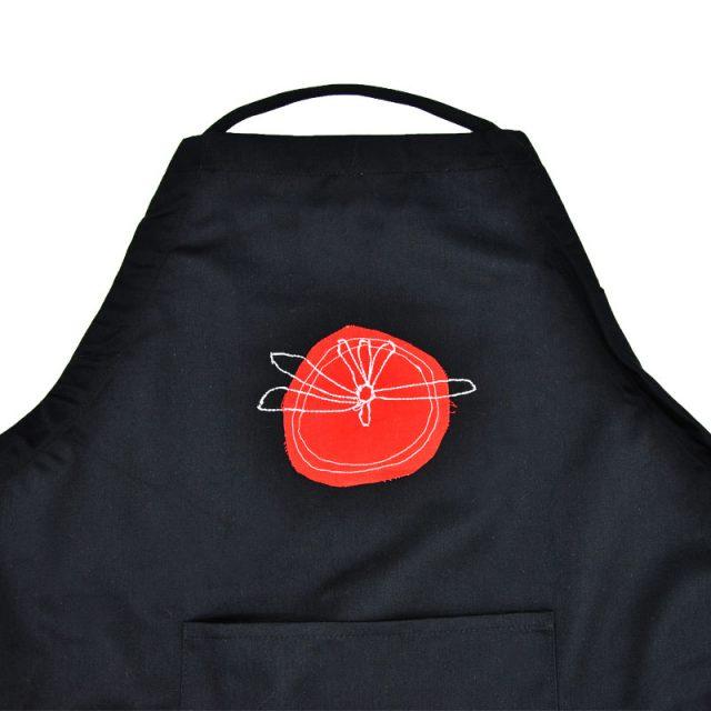 grembiule nero in cotone con inserto tessuto pomodoro